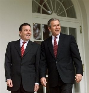 US President Bush, right, and German Chancellor Gerhard Schroeder walk together in the White House in Washington, in this file photo dated Thursday, March 29, 2001. Ex-Chancellor Gerhard Schroeder, who was vehemently opposed to the war in Iraq, described in an advance excerpts, published Saturday Oct. 21, 2006, of his soon to be published memoirs, 'Decisions: My Life in Politics' how he was suspicious of U.S. President Bush's constant references to his Christian faith.